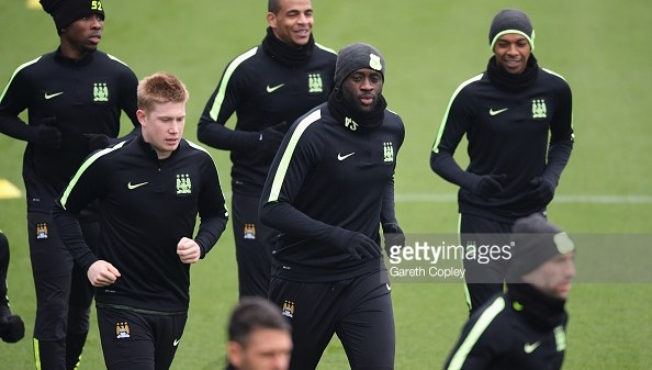 MANCHESTER, ENGLAND - APRIL 11: Kevin de Bruyne and Yaya Toure of Manchester City warm up with team mates during a training session ahead of the UEFA Champions League Quarter Final Second Leg match against Paris Saint-Germain at the Academy training ground on April 11, 2016 in Manchester, United Kingdom. (Photo by Gareth Copley/Getty Images)