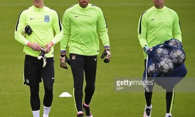 Manchester City's English goalkeeper Joe Hart (L) and Manchester City's Argentinian goalkeeper Willy Caballero (R) attend a team training session at the City Academy in Manchester, north west England, on May 3, 2016. Manchester City will play against Real Madrid CF in a UEFA Champions League semi-final second leg football match in Madrid on May 4. / AFP / PAUL ELLIS (Photo credit should read PAUL ELLIS/AFP/Getty Images)