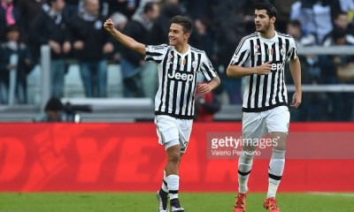 TURIN, ITALY - JANUARY 06: Paulo Dybala (L) of Juventus FC celebrates after scoring the opening goal with team mate Alvaro Morata during the Serie A match between Juventus FC and Hellas Verona FC at Juventus Arena on January 6, 2016 in Turin, Italy. (Photo by Valerio Pennicino/Getty Images)