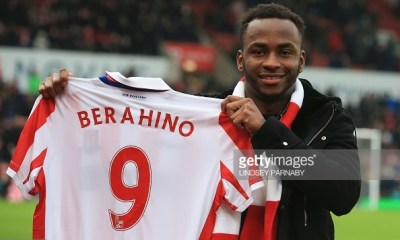 Stoke City's new English striker Saido Berahino poses with his jersey ahead of the English Premier League football match between Stoke City and Manchester United at the Bet365 Stadium in Stoke-on-Trent, central England on January 21, 2017. / AFP / Lindsey PARNABY / RESTRICTED TO EDITORIAL USE. No use with unauthorized audio, video, data, fixture lists, club/league logos or 'live' services. Online in-match use limited to 75 images, no video emulation. No use in betting, games or single club/league/player publications. / (Photo credit should read LINDSEY PARNABY/AFP/Getty Images)