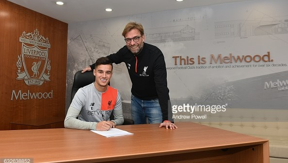 LIVERPOOL, ENGLAND - JANUARY 24: (EXCLUSIVE COVERAGE) Philippe Coutinho of Liverpool signs a new contract with Jurgen Klopp manager of Liverpool at Melwood Training Ground on January 24, 2017 in Liverpool, England. (Photo by Andrew Powell/Liverpool FC via Getty Images)