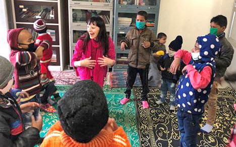 Zuleikha with kids at CanSupport Daycare