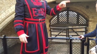 This tour guide is actually a Yeoman Warder. He gave an excellent tour and talked mostly about the Tudor period. On his uniform, E II R means Elizabeth II Regina (Regina in Latin means Queen)