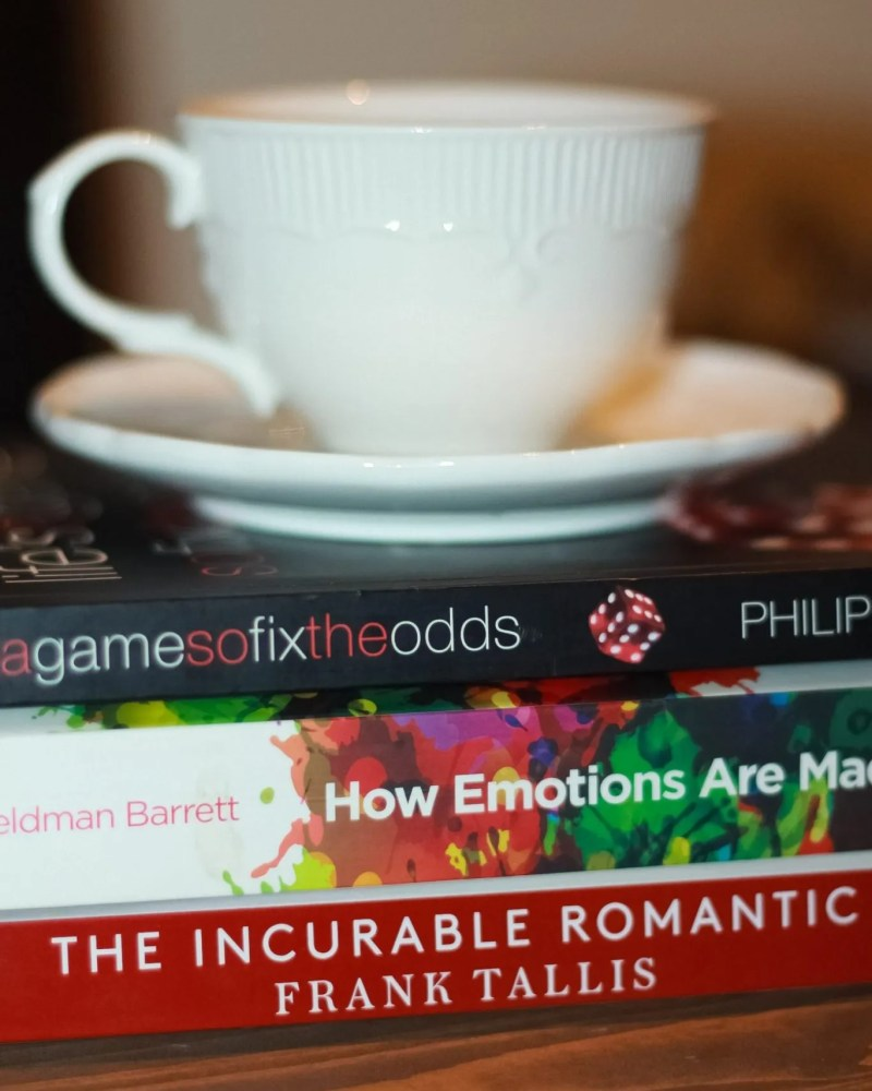 nonfictions book with a tea cup on top for blog on books that make you smart