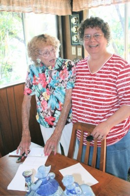 ISLAND TOUR - Dorothy Holm (left), granddaughter of Allbert Silcox who acquired the island in American Lake and named it Silcox Island, visits with Becky Huber, president of the Lakewood Historical Society, in the Holm home on the island. Silcox Island celebrated its centennial in 2005.