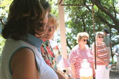 HOSTESSES ON SILCOX - Suzi Gierke (left to right) and Dorothy Holm hosted a group of nearly 60 members of the Lakewood Historical Society at Mrs. Holm's home recently. Mrs. Holm is the graddaughter of Albert Silcox who bought the island originally. Gierke is her daughter. Becky Huber, president of the Lakewood Historical Society and organizer of the tour is to the right of Mrs. Holm.