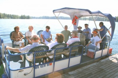 PONTOON BOATS IN USE - Residents of Silcox Island, and there are several living fulltime on the American Lake island, make heavy use of pontoon boats in bringing supplies and guests to and from the launch in Tillicum or American Lake Park. There is no bridge to the island and no public access.