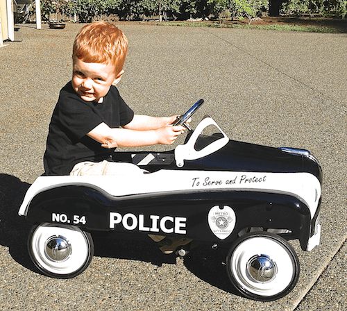 """P.S.  While I am careful to not be guilty of encouraging my grandchildren to ride motorcycles, I must confess I bought my grandson the pedal car pictured above.  Note this car answers the classic question from the old TV show, """"Car 54, where are you?"""""""