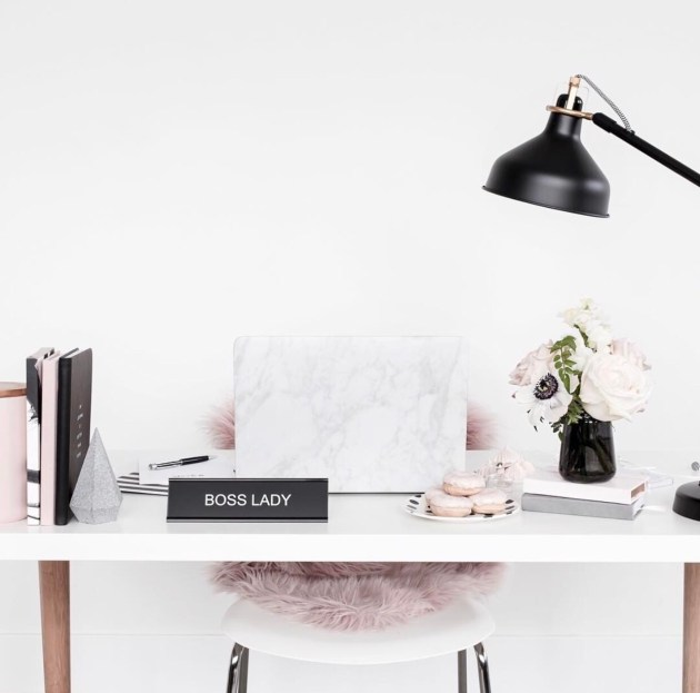 Chic office desk with pink and black decor and boss lady sign