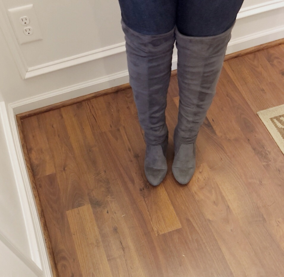 Close up shot of gray over the knee boots