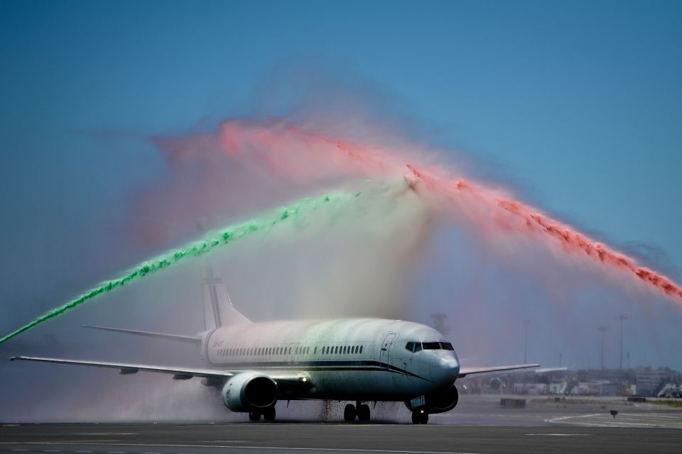 An airport firefighter's unit spray water in the national colours green and red as the victorious Portugal squad arrive back in Lisbon