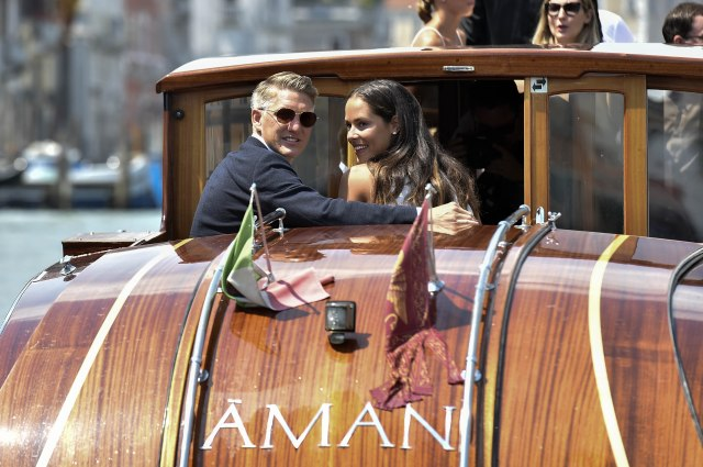 Bastian Schweinsteiger and Ana Ivanovic enjoy their post wedding shot on a Venice boat