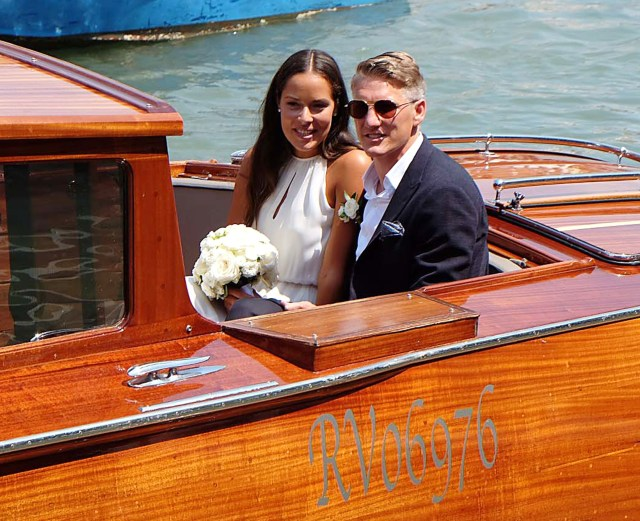 Bastian Schweinsteiger and Ana Ivanovic pose for the cameras moments after tying the knot