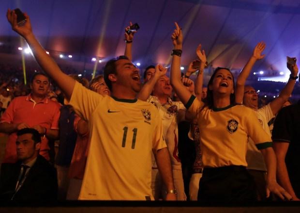 Spectators enjoy the spectacle at the Maracana on Friday night