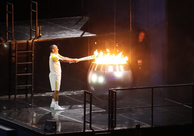 Former long-distance runner Vanderlei de Lima lit the Olympic cauldron at the end of the show
