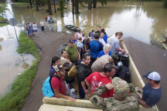 At least 20,000 people have been rescued from disaster zones so far, Governor Jon Bell has said