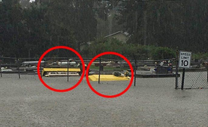 Nightmarish photograph shows caskets floating down a street in flood-hit Louisiana