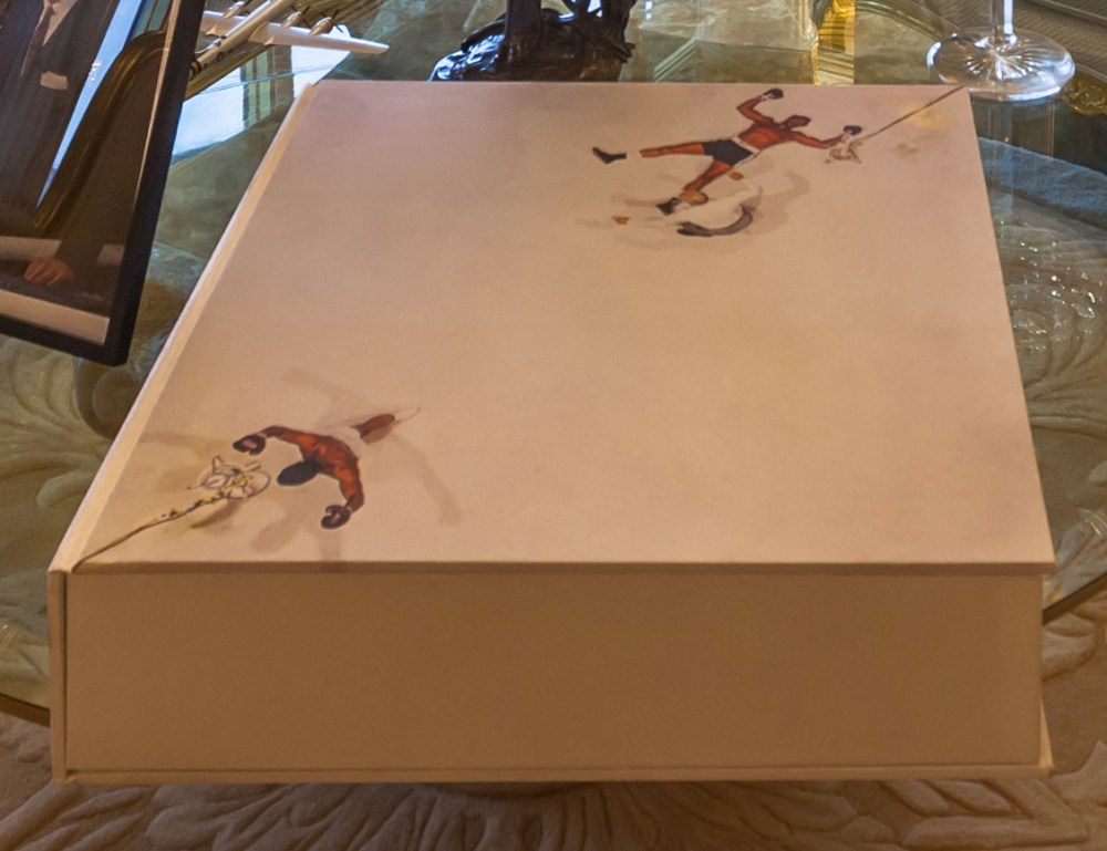 A rare signed copy of a Muhammad Ali tribute worth $15,000 takes pride of place on the table top