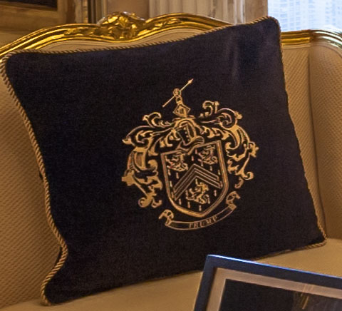 The Trump family coat of arms is even embossed on the cushions