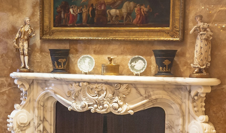 Athenian Greek vases are also displayed on top of the grand marble fireplace