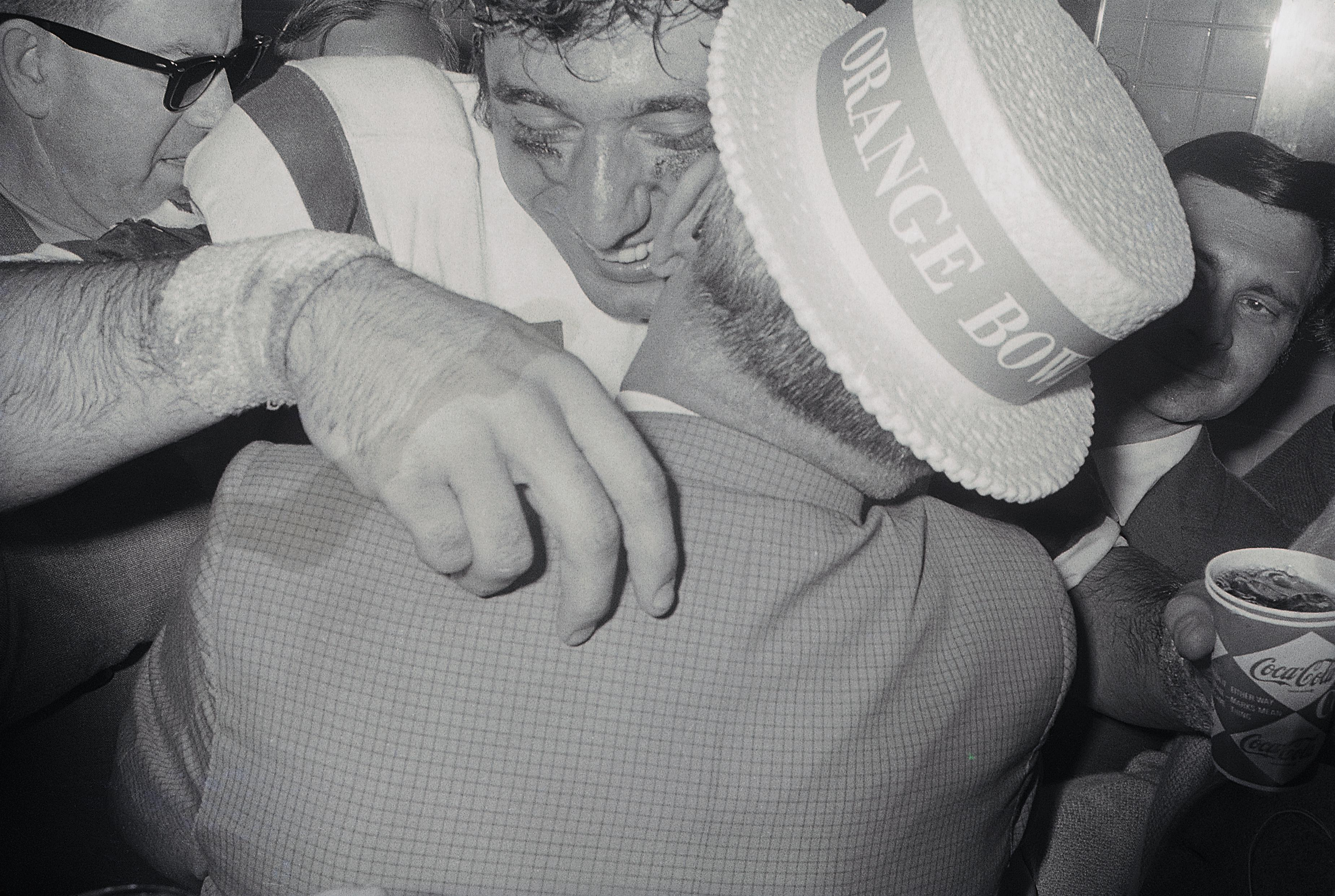 Namath hugs his dad in celebration after a major upset