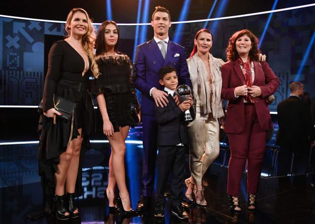 Ronaldo poses with partner Georgina Rodriguez (second left), his sisters and his son Cristiano Ronaldo Jr