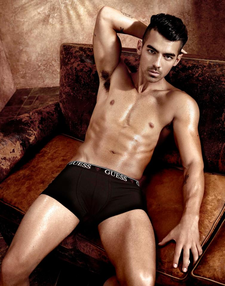 The popstar pulled off his trousers altogether and lounged back in his boxers