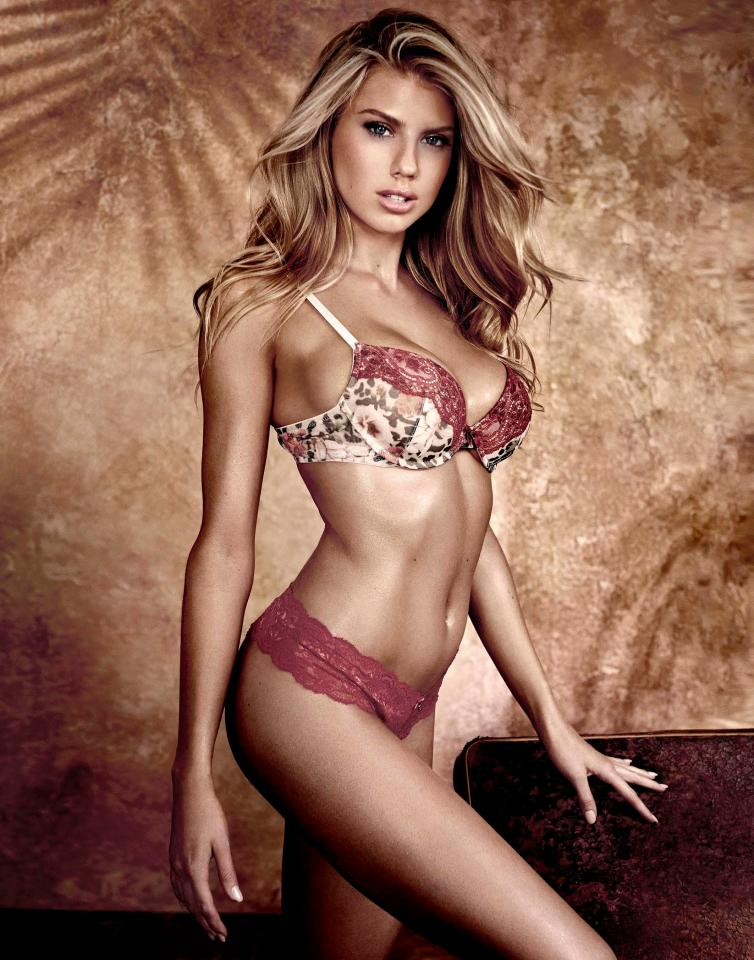 The model oozed sex appeal in a trendy red and cream lingerie set