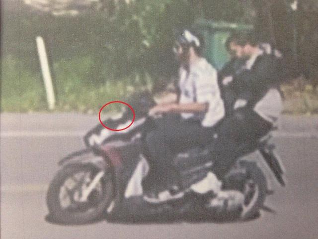 An image appearing to be from CCTV allegedly shows the pair fleeing the scene with what police think is a gun, circled