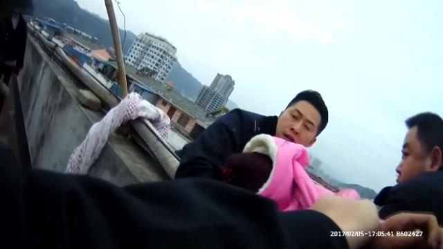 Cops jumped over the parapet pulling the woman to safety in a matter of seconds