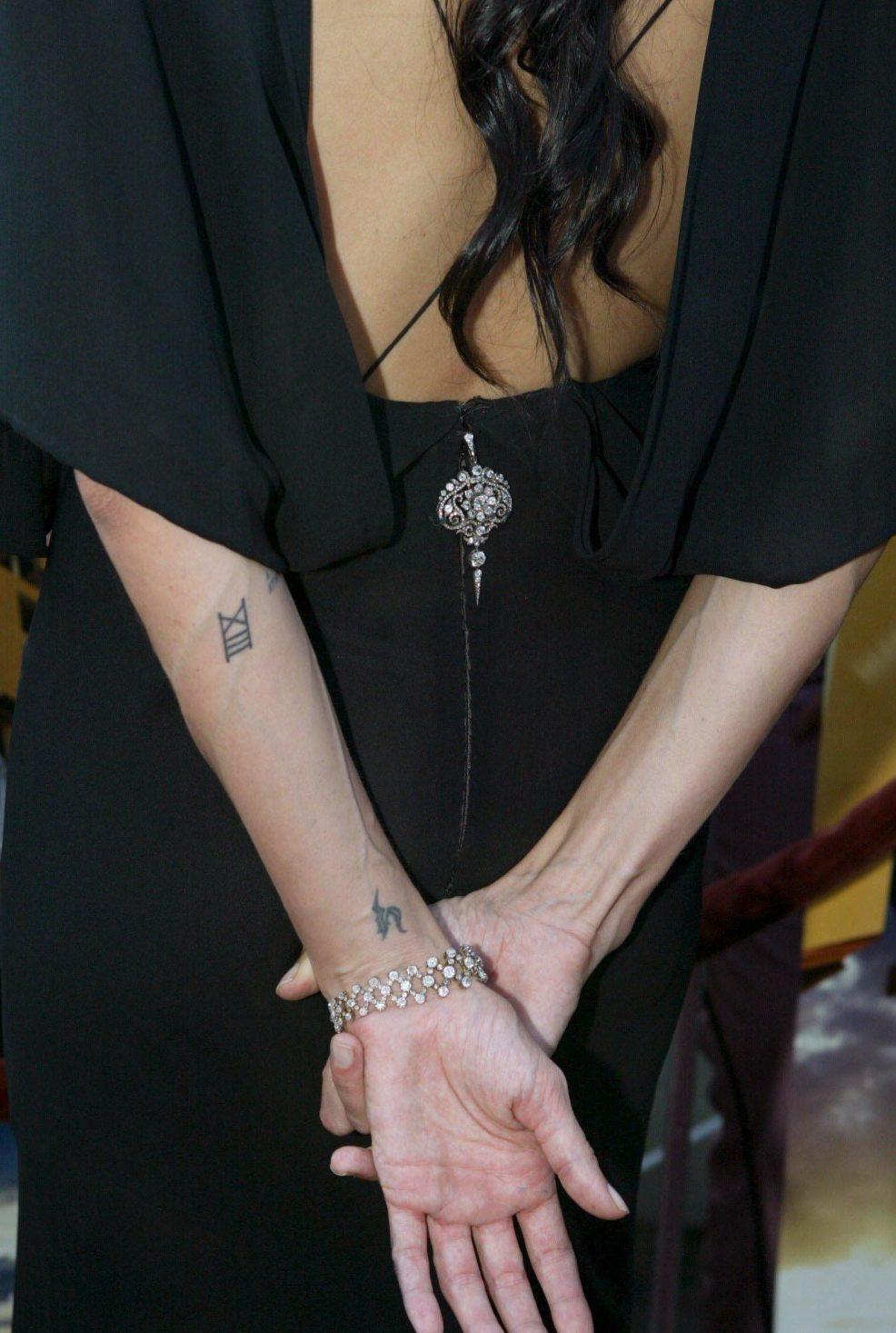 Angelina Jolie Tattoos From Billy Bob To Brad Pitts Spiritually