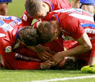 Torres was attended to by Atletico team-mates who tried to stop him swallowing his tongue
