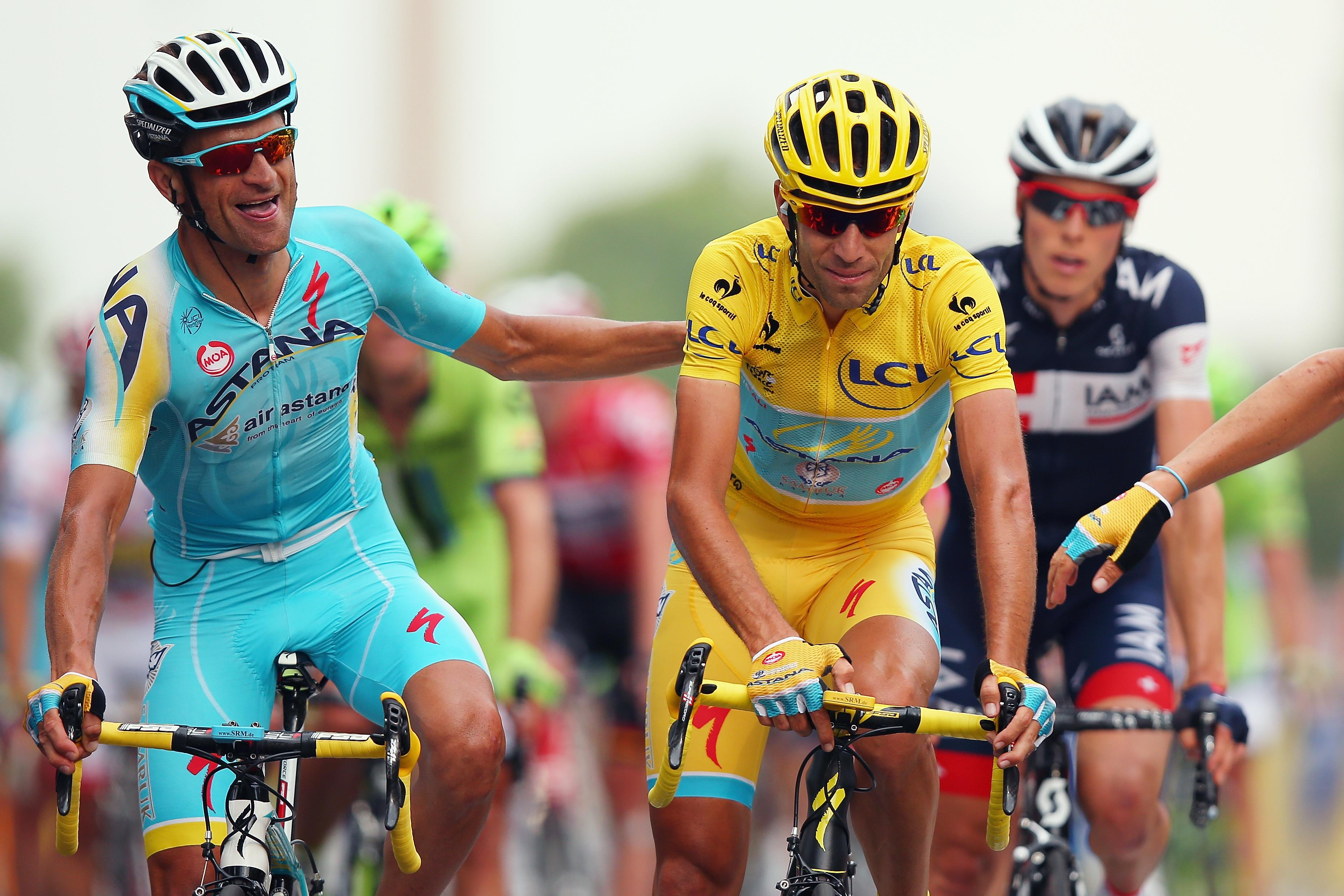 Michele Scarponi with Vincenzo Nibali when his Italian team-mate won the 2014 Tour de France