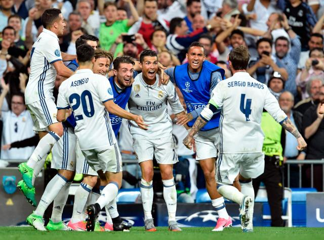 The Real Madrid players celebrate after Cristiano Ronaldo puts them in the lead