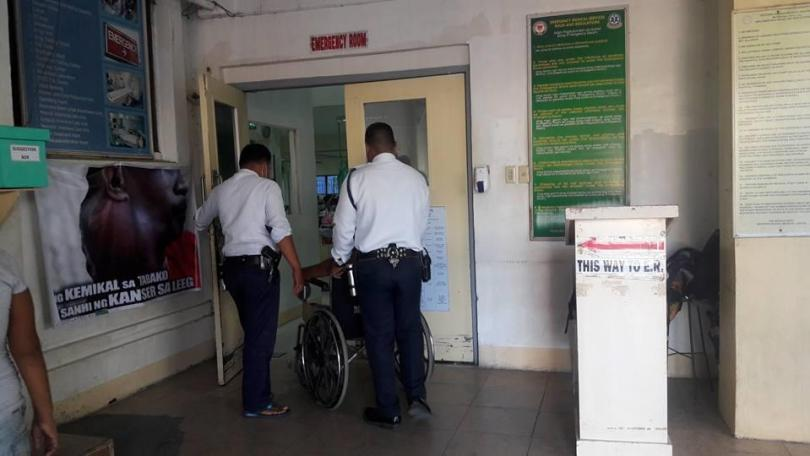 Betitta being wheeled to another ward