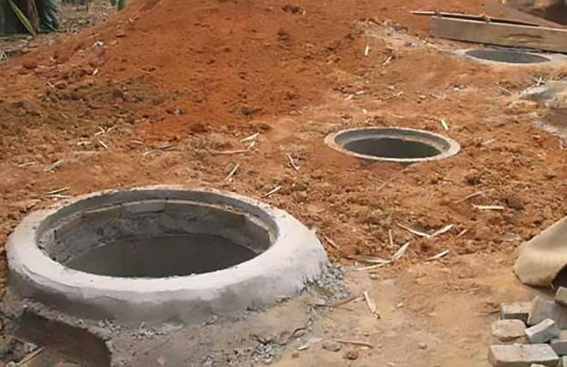 The six people died inside an underground septic tank filled with animal waste