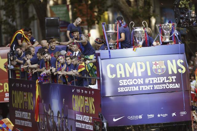 Barcelona celebrate winning a second Treble with open top bus parade