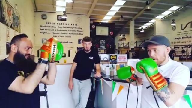 Conor McGregor then shows of his fast boxing skills, with his new gloves and pads