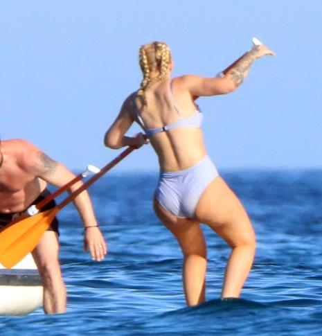 Iggy Azalea shows off her peachy bum in a lilac bikini as she relaxes on a yacht in Mexico