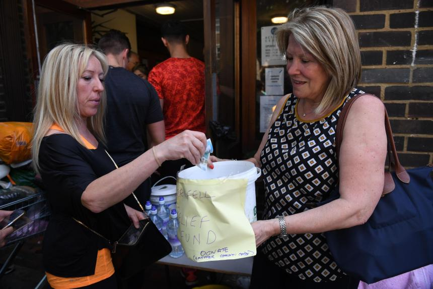 Wellwishers donate money to help survivors of the blaze which rocked a west London tower block