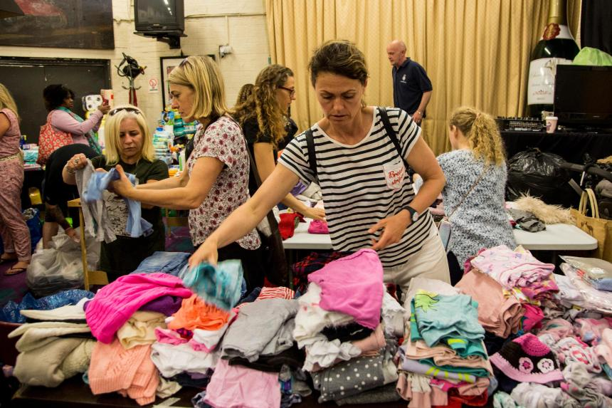 Rresidents help out at the Maxilla Social Club where food and clothes donations are being sorted
