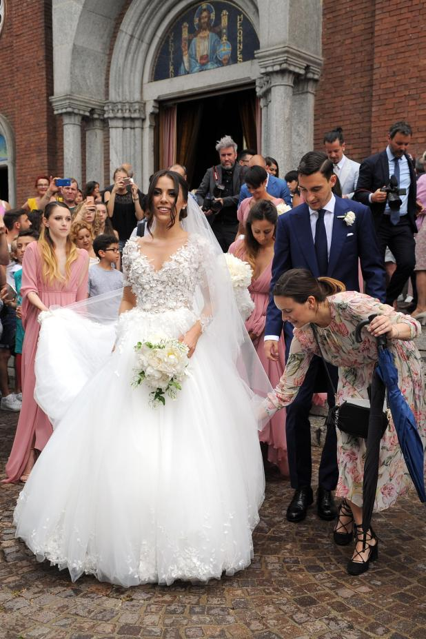 Cormanni - who has been with Darmian since they were teens - looked stunning in a floral wedding dress