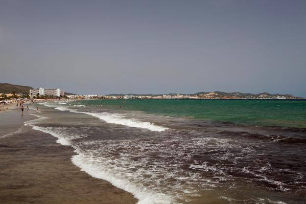 The Spanish pensioner was left with a gash on his hand after swimming off the popular beach