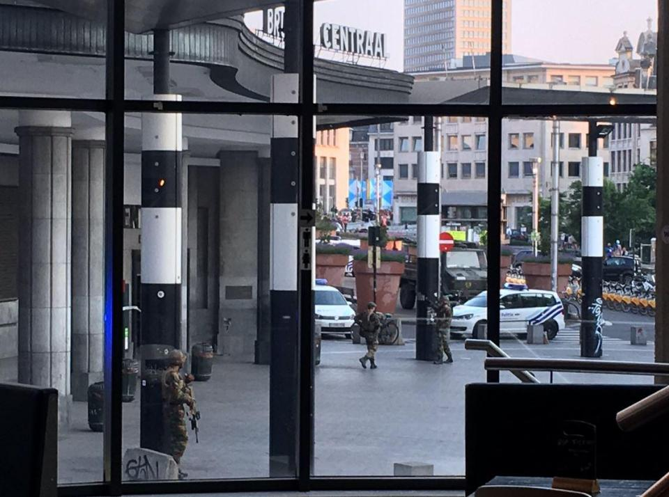 Soldiers can be seen outside the Brussels Central train station after reports a man with an explosives belt was shot by army