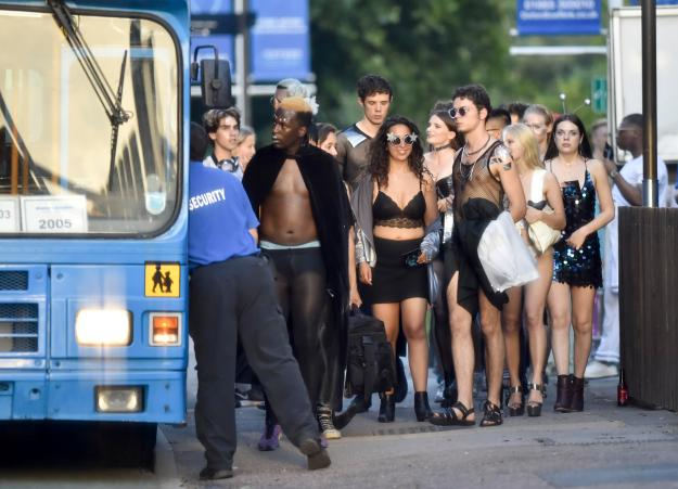 25-year-old Allamin Daggash, left, went topless under a black cape as he arrived at the party