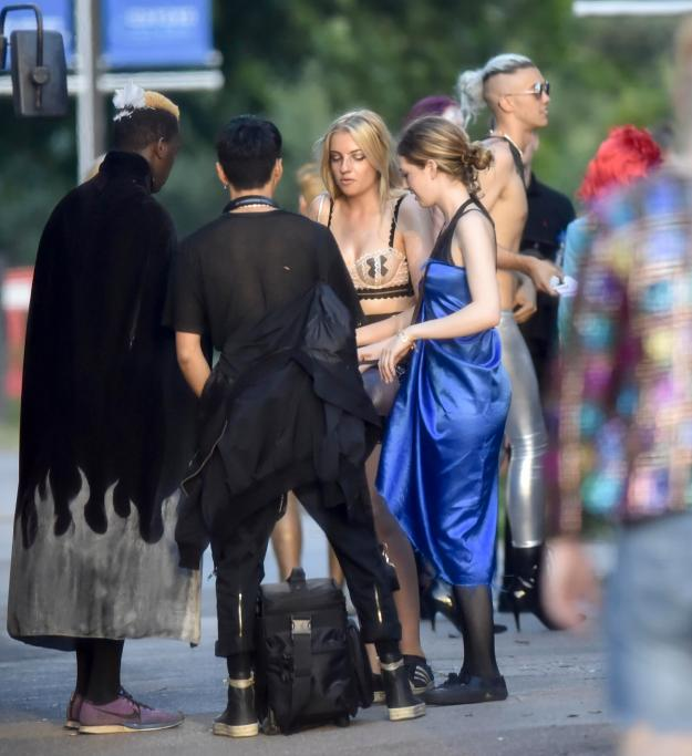 Charlotte Hyman, centre, was pictured in a nude and black lacy bra as she queued for the party in the Cotswolds