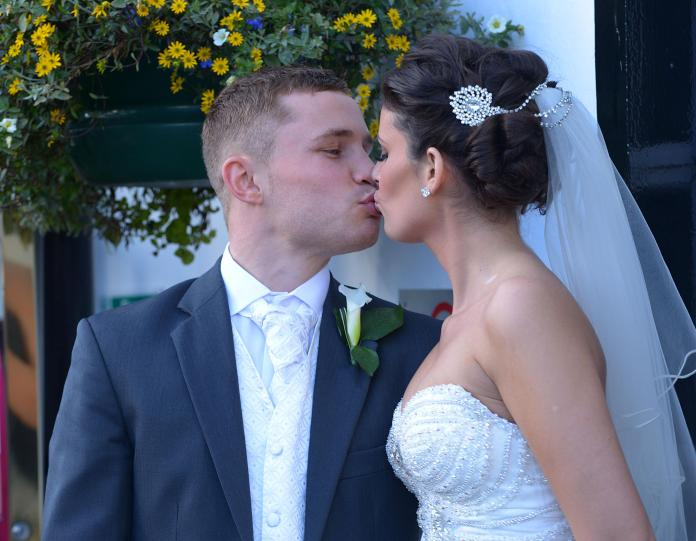 Carl Frampton plants a kiss on wife Christine on their wedding day