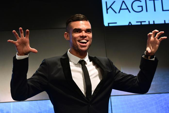 Pepe does his trademark pose as he is unveiled at Besiktas