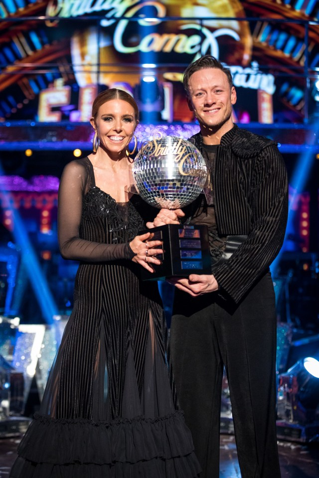 Stacey and Kevin pose proudly with the Strictly Come Dancing glitterball trophy