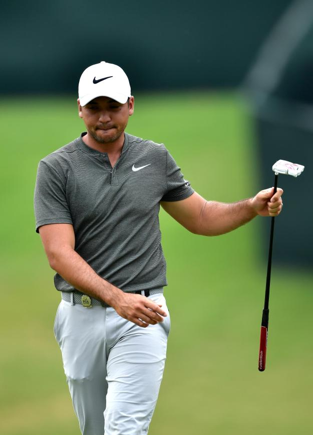 Jason Day, pictured here in round two, had a nightmare end to his third round
